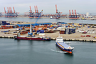 A ship departs the Port of Rotterdam, on Tuesday Oct. 27, 2009, in Rotterdam, the Netherlands. (Photo © Jock Fistick)