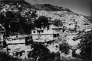 A slum called Jealousy climbs above the Petionville suburb of the country's capital, Port-au-Prince. Haiti's tiny elite, which owns the vast majority of the country's wealth, lives above the main city on cool hilltops away from the pervasive crime and poverty.....