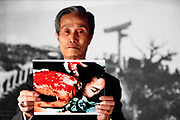 May 12, 2012; Nagasaki, Japan - Sumiteru Taniguchi holds up a photo of himself showing the burns he suffered from the atomic bomb blast in Nagasaki.<br /> Project Hibakusha : Hope for Peace