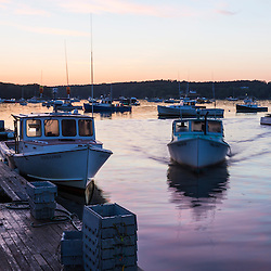 Dawn breaks on the wharf at the Friendship Lobster Co-op in Friendship, Maine.