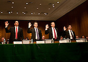 Apr 27,2010 - Washington, District of Columbia USA - .The first panel of current and former Goldman Sachs executives wait for the beginning of Tuesday's hearing before the Senate Homeland Security and Governmental Affairs subcommittee Hearing on Wall Street and the Financial Crisis .  Among them are Michael Swenson, Josh Birnbaum, Daniel Sparks and Fabrice Tourre, the 31-year-old Goldman employee who helped broker the deal that is at the center of the SEC's claim. (Credit Image: © Pete Marovich Images)