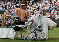 Tennis - 2019 Wimbledon Championships - Week Two, Friday (Day Eleven)<br /> <br /> Men's Singles, Semi-Final: Rafael Nadal (ESP) v Roger Federer (SUI)<br /> <br /> Roger Federer changes his shirt on Centre Court.<br /> <br /> COLORSPORT/ANDREW COWIE
