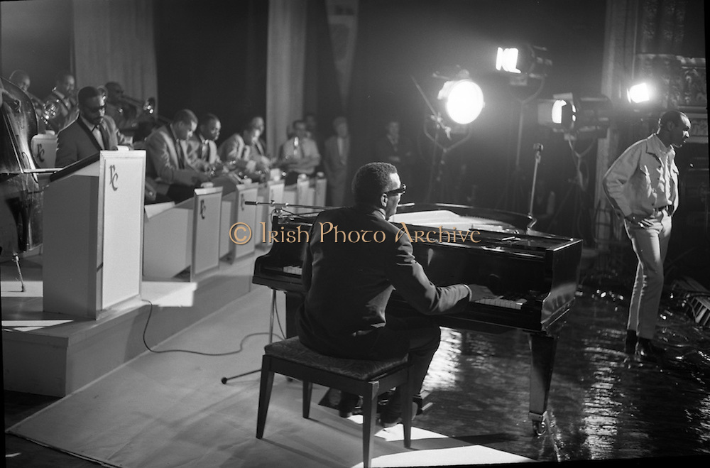 """Singer Ray Charles at the piano at the Gaiety Theatre, filming a scene for the film """"Ballad in Blue"""".<br /> 09.06.1964"""