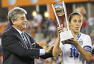 Feb 21, 2016; Houston, TX, USA; USA midfielder Carli Lloyd (10) is handed the championship trophy after USA defeated Canada 2 to 0 in the 2016 CONCACAF women's Olympic soccer tournament at BBVA Compass Stadium. USA won 2 to 0. Mandatory Credit: Thomas B. Shea-USA TODAY Sports