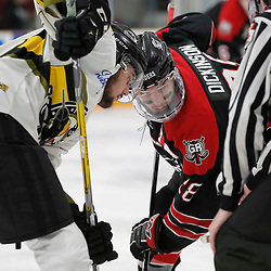 TRENTON, ON  - MAY 5,  2017: Canadian Junior Hockey League, Central Canadian Jr. &quot;A&quot; Championship. The Dudley Hewitt Cup. Game 7 between The Georgetown Raiders and The Powassan Voodoos. Josh Dickinson #28 of the Georgetown Raiders and  Tyson Gilmour #23 of the Powassan Voodoos during the face-off <br /> (Photo by Amy Deroche / OJHL Images)