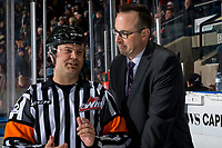 KELOWNA, CANADA - FEBRUARY 23:  Referee Chris Crich speaks to Kelowna Rockets' assistant coach Kris Mallette against the Kamloops Blazers on February 23, 2019 at Prospera Place in Kelowna, British Columbia, Canada.  (Photo by Marissa Baecker/Shoot the Breeze)