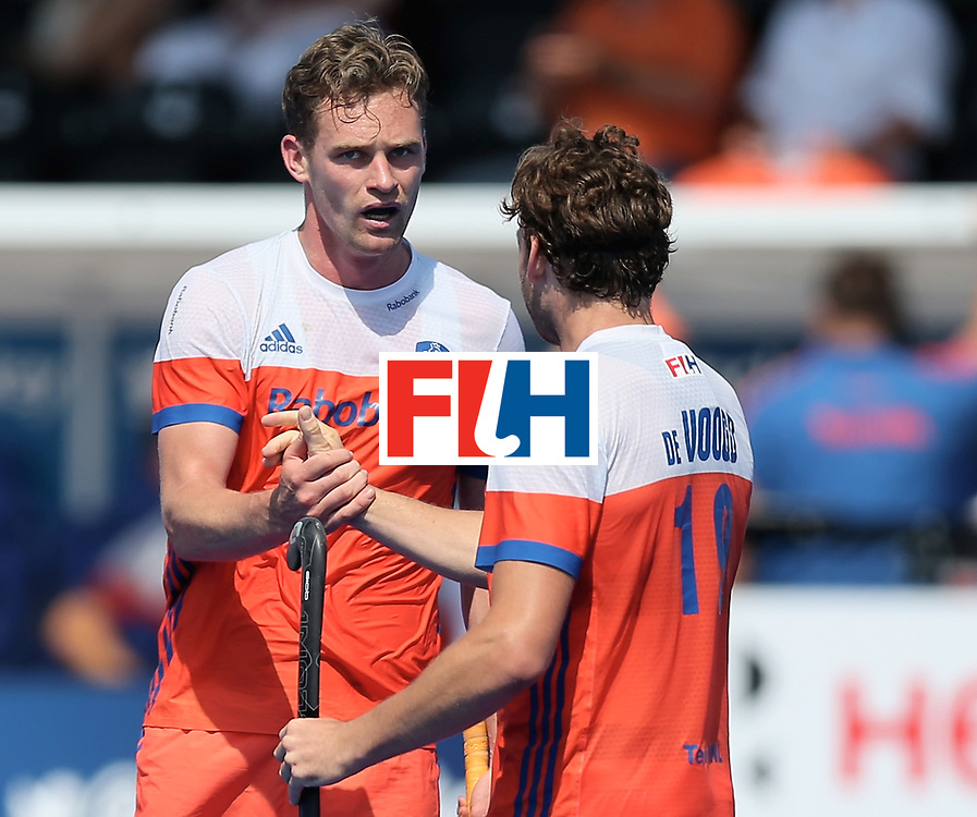 LONDON, ENGLAND - JUNE 19: Mirco Pruijser of the Netherlands celebrates scoring his teams third goal with teammate Bob de Voogd during the Hero Hockey World League Semi-Final match between Netherlands and Canada at Lee Valley Hockey and Tennis Centre on June 19, 2017 in London, England. (Photo by Alex Morton/Getty Images)