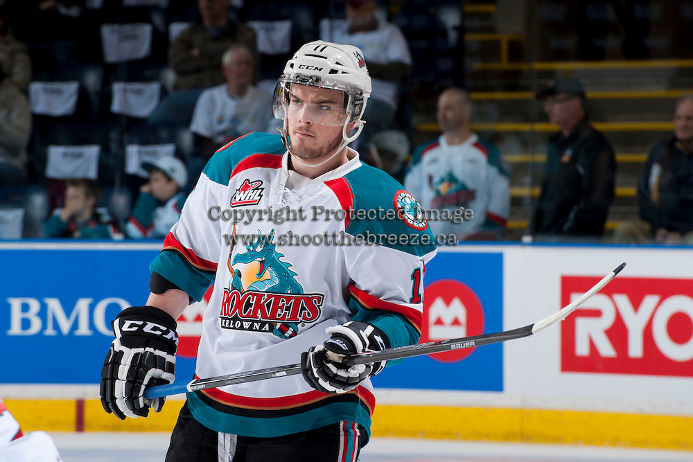 KELOWNA, CANADA - APRIL 18: Carter Rigby #11 of the Kelowna Rockets skates during warm up against the Portland Winterhawks on April 18, 2014 during Game 1 of the third round of WHL Playoffs at Prospera Place in Kelowna, British Columbia, Canada.   (Photo by Marissa Baecker/Shoot the Breeze)  *** Local Caption *** Carter Rigby;