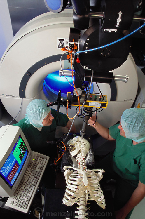 """Researcher Tim Leuth and surgeon Martin Klein with a medical robot called a """"SurgiScope"""" at the Virchow Campus Clinic, Humboldt University, Berlin, Germany. The SurgiScope is an image guided surgery support device comprised of a robotic tool holder, advanced image handling software and a position sensor. The robotic system can be used for surgical planning and interoperative guidance."""