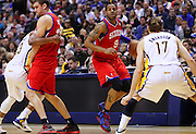 April 21, 2012; Indianapolis, IN, USA; Philadelphia 76ers small forward Andre Iguodala (9) dribbles the ball around the backcourt against Indiana Pacers center Louis Amundson (17) at Bankers Life Fieldhouse. Philadelphia defeated Indiana 109-106. Mandatory credit: Michael Hickey-US PRESSWIRE
