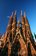 Sagrada Familia by Antoni Gaudi. The Nativity Facade at sunrise.