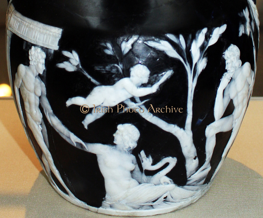 The Portland Vase. Cameo glass, probably made in Rome About 15BC - AD 25. The Portland Vase is one of the finest surviving pieces Roman glass, and is named after the Duke of Portland who owned it from 1785 to 1945. It made of cameo glass a technique in which vessels and plaques, sometimes free-blown, sometimes cast, are created with two layers of glass. The outer layer (usually white) is carved away from the underlying dark layer (usually blue) to create decorative scenes and patterns.