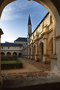 West and north galleries of the main Grand-Moutier Cloister at Fontevraud Abbey, Fontevraud-l'Abbaye, Loire Valley, Maine-et-Loire, France. The cloister, built to house virgin nuns, was originally Romanesque but was rebuilt in the 16th century. Renee de Bourbon renovated the south gallery in Gothic style in 1519, then Louise de Bourbon rebuilt the 3 other galleries in classical style 1530-60. The abbey was founded in 1100 by Robert of Arbrissel, who created the Order of Fontevraud. It was a double monastery for monks and nuns, run by an abbess. The abbey is listed as a historic monument and a UNESCO World Heritage Site. Picture by Manuel Cohen