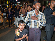 20 OCTOBER 2015 - YANGON, MYANMAR: A Shia man and his son participate in a procession for Ashua at Punja Mosque in Yangon. Ashura commemorates the death of Hussein ibn Ali, the grandson of the Prophet Muhammed, in the 7th century. Hussein ibn Ali is considered by Shia Muslims to be the third imam and the rightful successor of Muhammed. He was killed at the Battle of Karbala in 610 CE on the 10th day of Muharram, the first month of the Islamic calendar. According to Myanmar government statistics, only about 4% of the population is Muslim. Many Muslims have fled Myanmar in recent years because of violence directed against Burmese Muslims by Buddhist nationalists.   PHOTO BY JACK KURTZ
