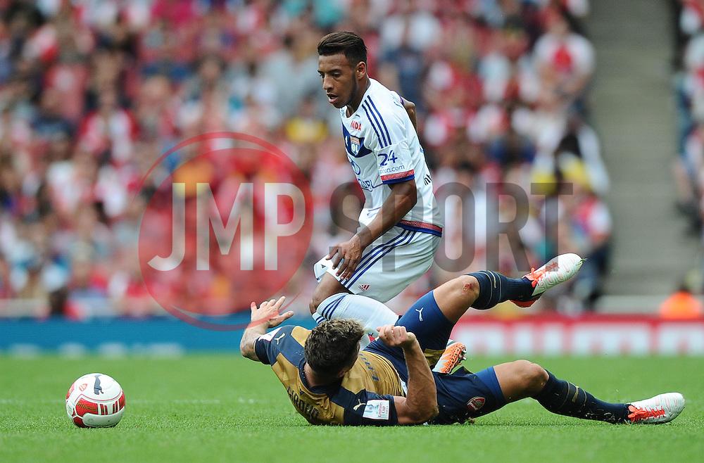 Corentin Tolisso of Lyon battles for the ball with Olivier Giroud of Arsenal  - Mandatory by-line: Joe Meredith/JMP - 25/07/2015 - SPORT - FOOTBALL - London,England - Emirates Stadium - Arsenal v Lyon - Emirates Cup
