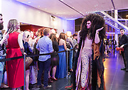 """Model Craig Alan display's s the """"Leo, Reimagined"""" hair sculpture during """"Hair Affair: The Art of Hair"""" at Madison Museum of Contemporary Art in Madison, WI on Thursday, April 25, 2019. The sixth biennial brought an array of designers and stylists from across Wisconsin to create under the theme of """"Zodiac."""""""