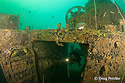diver explores the wreck of an American WWII era<br /> LCU ( Landing Craft Utility ) or LCT ( Landing Craft - Tank )<br /> sunk in 8-21m of water in Triboa Bay, within Subic Bay,<br /> Philippines, MR 379