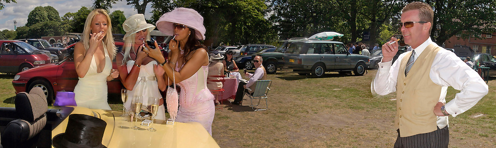Melissa Walker, Trudy Webb,  Angie Farey doing makeup watched by Rory England, in the Number 1 car-park. Ascot, 16 June 2004. SUPPLIED FOR ONE-TIME USE ONLY> DO NOT ARCHIVE. © Copyright Photograph by Dafydd Jones 66 Stockwell Park Rd. London SW9 0DA Tel 020 7733 0108 www.dafjones.com