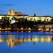 Skyline of Prague (Praha) at night overlooking the River Vltava toward the Charles Bridge and Prague Castle
