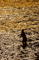 Man fishing in the ocean, Anse Vata, Noumea, Grand Terre, New Caledonia