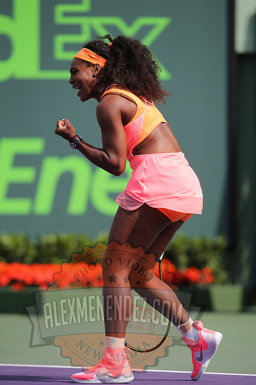 Serena Williams, of the United States, reacts after winning a point against Monica Niculescu, of Romania, during their match at the Miami Open tennis tournament on Saturday, March 28, 2015 in Key Biscayne, Florida. (AP Photo/Alex Menendez)