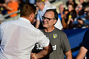 Leeds United manager Marcelo Bielsa talking to Oxford United manager Karl Robinson before the Pre-Season Friendly match between Oxford United and Leeds United at the Kassam Stadium, Oxford, England on 24 July 2018. Picture by Graham Hunt.