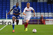 Ousmane Fané of Oldham Athletic chases Michael Jacobs of Wigan Athletic during the EFL Cup match between Oldham Athletic and Wigan Athletic at Boundary Park, Oldham, England on 9 August 2016. Photo by Simon Brady.