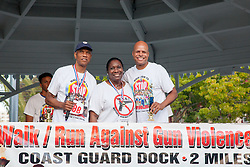 (L-R) James and Celia Carroll with overall winner Antonio Maysonet.  Virgin Islanders gear up for the 2-mile Virgin Islands Walk/Run Against Gun Violence along the Charlotte Amalie Waterfront.   Proceeds from the event go to benefit the Jason Carroll Memorial Fund for college scholarships.  St. Thomas, VI.  22 May 2016.  © Aisha-Zakiya Boyd