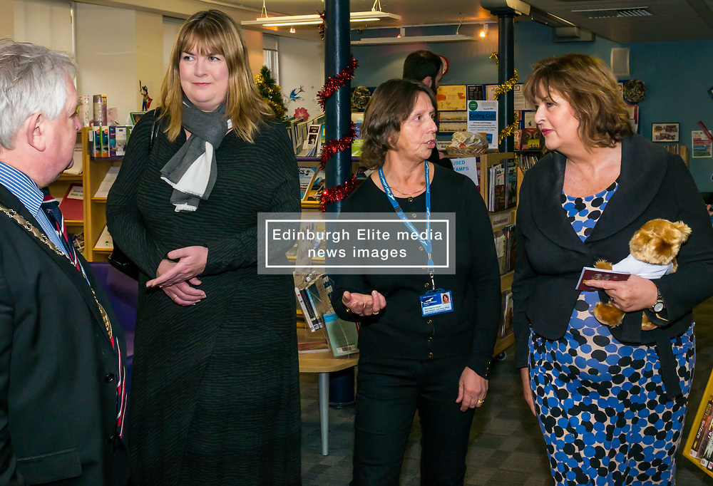 Pictured: Scottish Government Public Libraries Funding Announcement. Culture Minister Fiona Hyslop announces this year's successful bids to the £450,000 Public Library Improvement Fund (PLIF) at the John Grey Centre, Haddington Library, Haddington, East Lothian, Scotland, United Kingdom.  PLIF has been supporting innovative library projects since 2006 which help both individuals and communities. Fiona Hyslop talking to Trina Gavan, Area Librarian with Provost of East Lothian, John McMillan. 13 December 2018  <br /> <br /> Sally Anderson | EdinburghElitemedia.co.uk