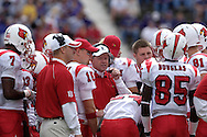Louisville head coach Bobby Petrino (C) talks with his Cardinals during a time out against Kansas State at Bill Snyder Family Stadium in Manhattan, Kansas, September 23, 2006.  The 8th ranked Louisville Cardinals beat K-State 24-6.