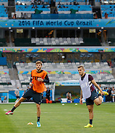 Adam Lallana (L) and Jack Wilshere (R) of England warm up during the England training session the day before their final Group D match against Costa Rica at Mineirão, Belo Horizonte, Brazil. <br /> Picture by Andrew Tobin/Focus Images Ltd +44 7710 761829<br /> 23/06/2014