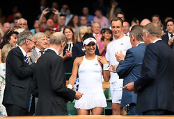 Heather Watson and Henri Kontinen following defeat to Martina Hingis and Jamie Murray on day thirteen of the Wimbledon Championships at The All England Lawn Tennis and Croquet Club, Wimbledon.