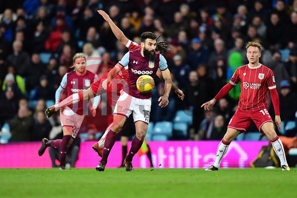 Mile Jedinak of Aston Villa fouls Bobby Reid of Bristol City  - Mandatory by-line: Joe Meredith/JMP - 01/01/2018 - FOOTBALL - Villa Park - Birmingham, England - Aston Villa v Bristol City - Sky Bet Championship