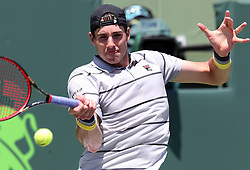 April 1, 2018 - FL, USA - John Isner returns a ball hit by Alexander Zverev on Sunday, April 1, 2018 during the men's final at the Miami Open on Key Biscayne, Fla. (Credit Image: © Charles Trainor Jr/TNS via ZUMA Wire)