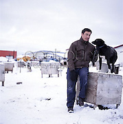 KOTZEBUE, AK - OCTOBER 01: Native Alaskan and Eskimo John Baker, winner of the 2011 Iditarod, poses at his dog kennel for a Self Assignment in Kotzebue, Alaska, 2009. (Photo by Brian Adams/Contour by Getty Images)<br /> EXCLUSIVLY AVAILABLE ON CONTOUR IMAGES<br /> WWW.CONTOURPHOTOS.COM