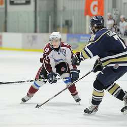 "FORT FRANCES, ON - Apr 29, 2015 : Central Canadian Junior ""A"" Championship, game action between the Toronto Patriots and the Dryden GM Ice Dogs, game three of the Dudley Hewitt Cup, Cole Golka #22 of the Dryden GM Ice Dogs plays the puck<br /> (Photo by Amy Deroche/ OJHL Images)"