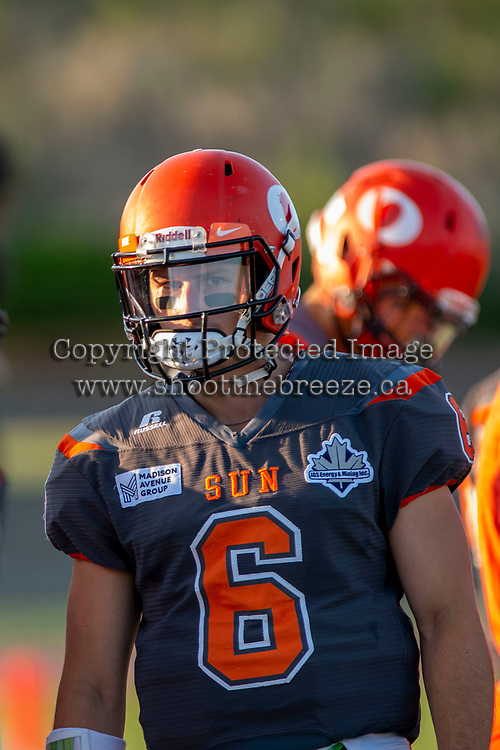 KELOWNA, BC - AUGUST 3:  Ethan Newman #6 of Okanagan Sun stands at the sidelines against the Kamloops Broncos at the Apple Bowl on August 3, 2019 in Kelowna, Canada. (Photo by Marissa Baecker/Shoot the Breeze)