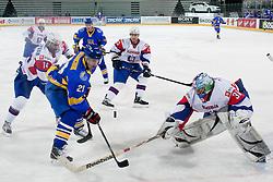 Kostyantyn Kasyanchuk of Ukraine vs Robert Kristan of Slovenia during ice-hockey match between Slovenia and Ukraine at IIHF World Championship DIV. I Group A Slovenia 2012, on April 19, 2012 at SRC Stozice, Ljubljana, Slovenia. (Photo By Matic Klansek Velej / Sportida.com)