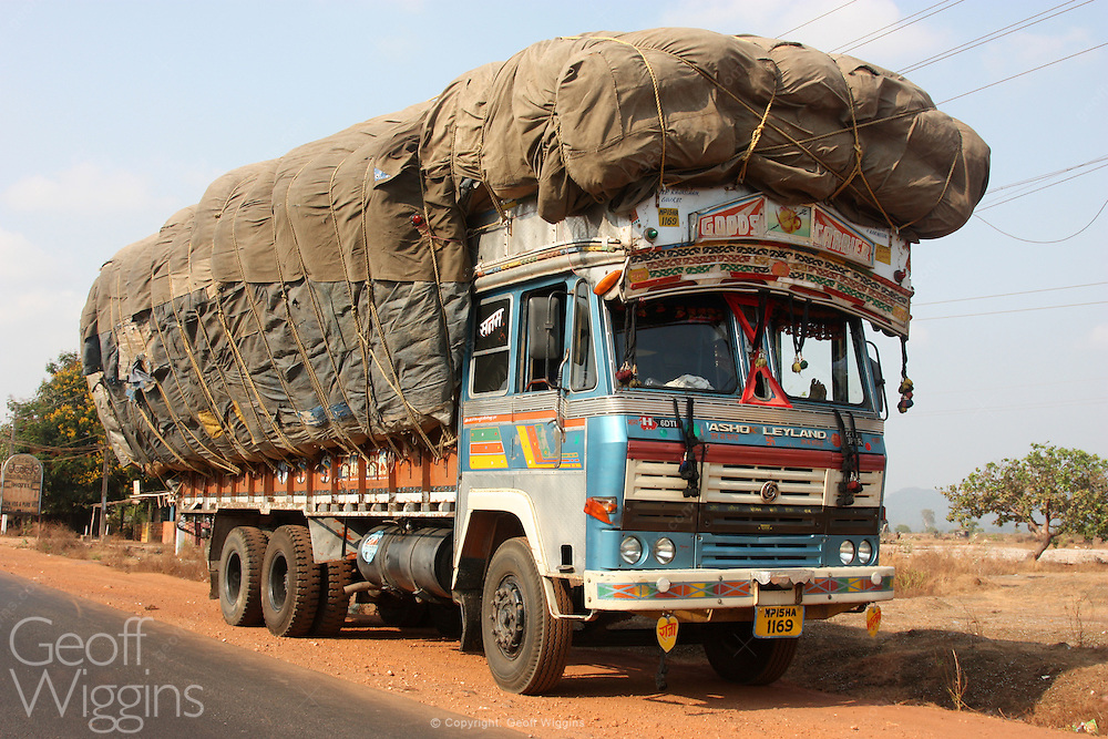 Overloaded Indian freight truck carrying cargo of cotton on National Highway 17 Karnataka, India