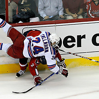28 April 2009:   New York Rangers right wing Ryan Callahan (24) is upended by Washington Capitals defenseman Brian Pothier (2) in the 1st period in the seventh game of the Eastern Conference NHL quarterfinal playoff game at the Verizon Center in Washington, D.C.  The Washington Capitals defeated the New York Rangers 2-1 in the Eastern Conference NHL quaterfinal playoff to advance to the second round of the playoffs.