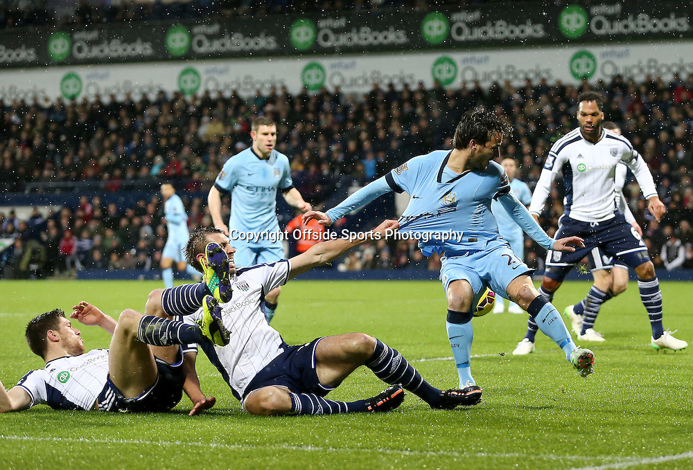 26th December 2014 - Barclays Premier League - West Bromwich Albion v Manchester City - David Silva of Manchester City is pulled back in the box by Gareth McAuley of West Bromwich Albion - Photo: Paul Roberts / Offside.