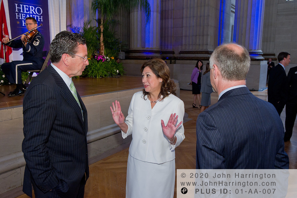The Honorable Hilda L. Solis (center), U.S. Secretary of Labor, speaks with Rene Lerer (right), M.D., chairman and CEO of Magellan Health Services and Dannel Malloy (left), Gov. of Connecticut, at the Hero Health Hire Initiative Summit at the Andrew W. Mellon Auditorium in Washington, DC on June 22nd, 2011.
