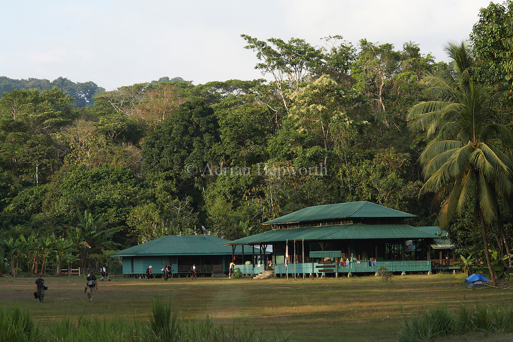 Tourists and film crew at Sirena Ranger Station, Corcovado National Park, Osa Peninsula, Costa Rica. <br />