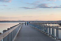 Two adult females on Boulevard Park Boardwalk, Taylor Dock on Bellingham Bay, Bellingham Washington