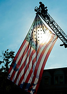 A firefighter hangs a large American flag before the start of a 9/11 ceremony at the Global War on Terrorism Memorial Monday September 11, 2017 at old Bucks County Courthouse in Doylestown, Pennsylvania. (Photo by William Thomas Cain)
