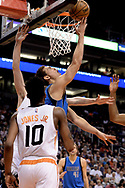 Apr 9, 2017; Phoenix, AZ, USA; Dallas Mavericks forward Dwight Powell (7) puts up the ball in traffic against the Phoenix Suns in the first half of the NBA game at Talking Stick Resort Arena. Mandatory Credit: Jennifer Stewart-USA TODAY Sports