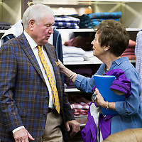 Jimmy Long, left, speaks with Nancy Diffee during Long's retirement reception at MLM Clothiers in downtown Tupelo.