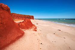 Stunning red pindan cliffs meet white sand at James Price Point