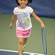 August 16, 2014, New Haven, CT:<br /> A young fan runs during a tennis clinic as part of Kids Day on day three of the 2014 Connecticut Open at the Yale University Tennis Center in New Haven, Connecticut Sunday, August 17, 2014.<br /> (Photo by Billie Weiss/Connecticut Open)