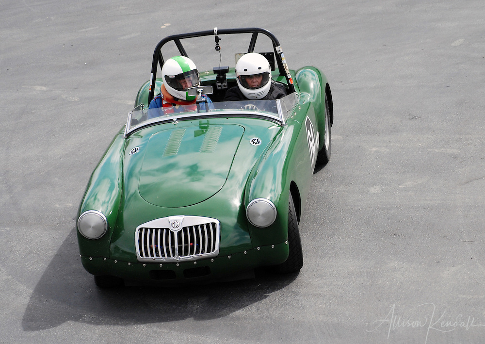 Green MG vintage racecar, during HMSA events at Laguna Seca